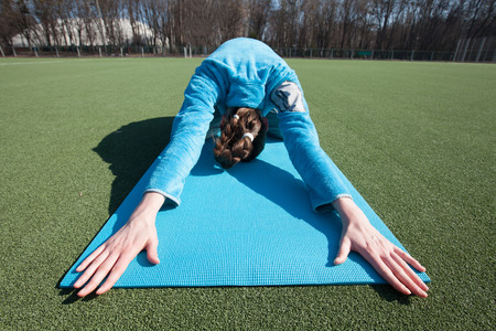 ashtanga: A woman practicing yoga in a park Stock Photo