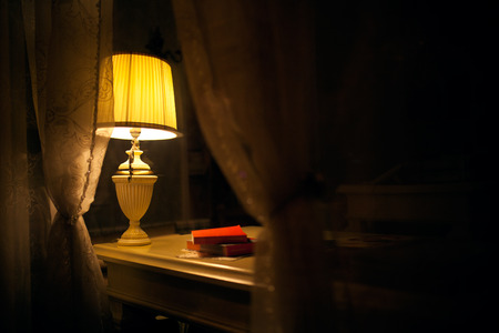 lamp shade: old fashion table lamp in interior shot through window glass Stock Photo