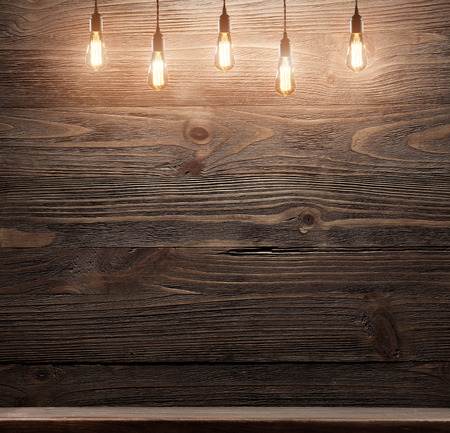 background wood: Wood shelf grunge industrial interior with edison light bulb