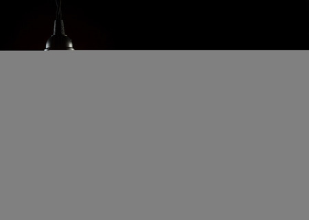 thomas: A classic Edison light bulb on black background with space for text