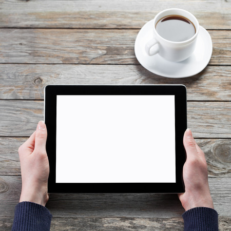 male hands holding digital tablet computer with isolated screen over cafe background