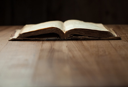 holy bible: Image of an old Holy Bible on wooden background in a dark space