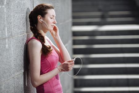 sports wear: Woman listening to mp3 player wearing sports wear Stock Photo