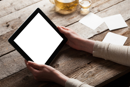 woman shows screen of digital tablet in her hands