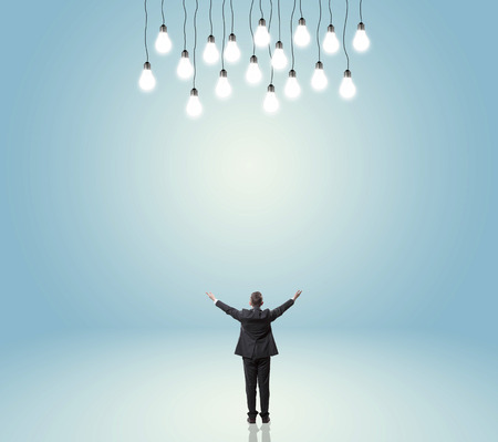 businessman looking at light bulbs background photo