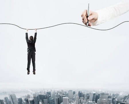 rope: Man holding on a rope