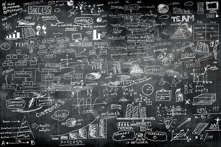 business idea concept on wall blackboard blackground