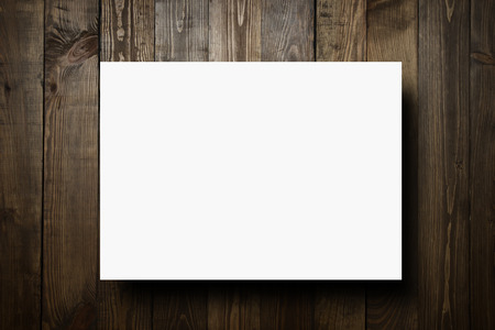 white paper: weathered barn wood background with blank white paper