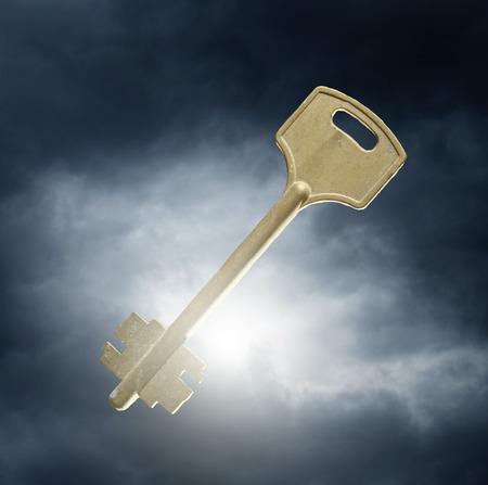homebuyer: key against dramatic sky background