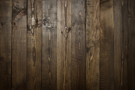 wooden surface: weathered barn wood background with knots and nail holes