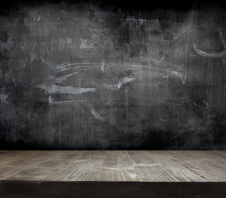 Blank cleaned chalkboard with wooden background