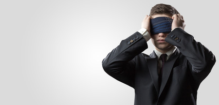 blindness: Portrait of a businessman with a bandage on his eyes