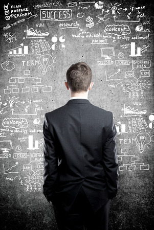 new development: man and business strategy on the wall