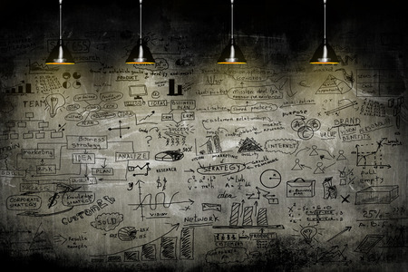 business strategy on the wall with lamp