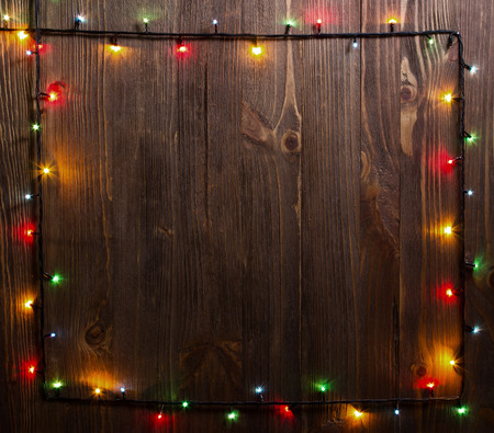 Christmas background. planked wood with lights and free text space Banco de Imagens