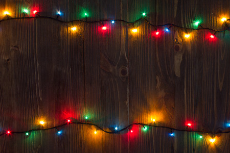 christmas decorations: Christmas background. planked wood with lights and free text space Stock Photo