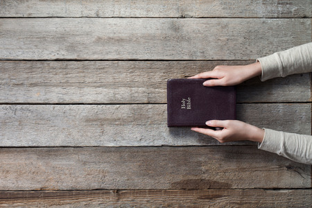 bibles: christian woman holding the bible. top angle of view