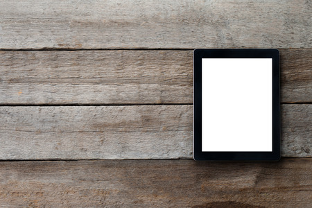 digital tablet on the table with isolated screen for your image and a copy space