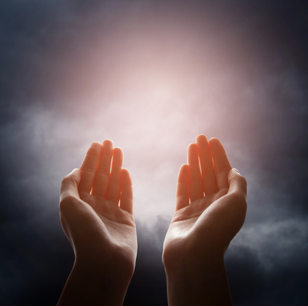 jesus clouds: Hand reaching for the cloud in the sky Stock Photo
