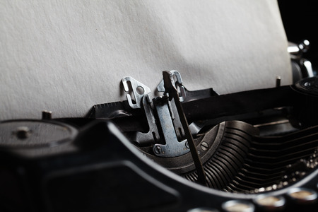 typewriter machine: typewriter with aged textured paper sheet