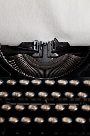 typewriter with aged textured paper sheet