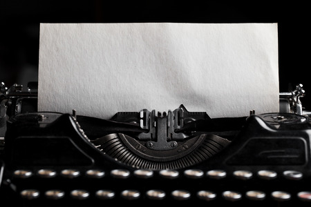 antique background: typewriter with paper sheet. Space for your text