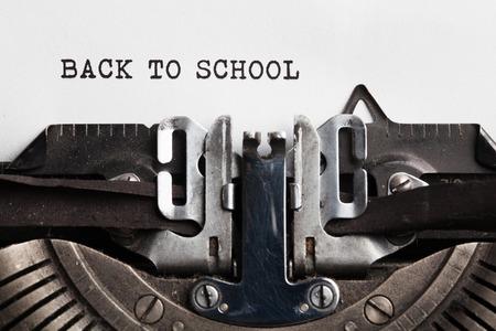 advertising design: Back to School poster. typewriter with paper sheet.
