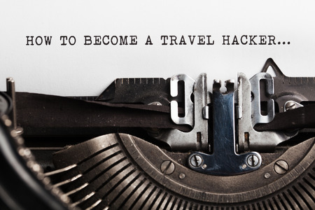 nonconformity: Become a Travel Hacker sign with typewriter
