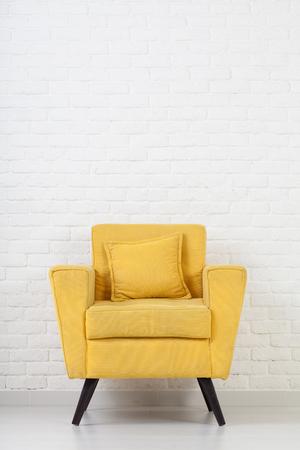 modern chair: White wall texture with a retro armchair