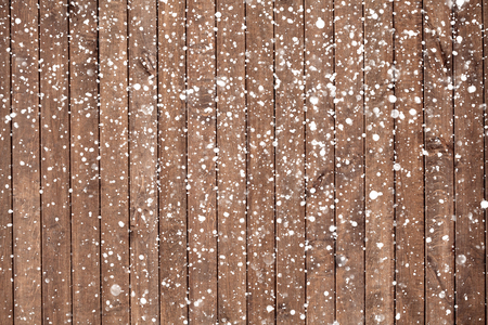 snow tree: Christmas background with falling snow over wooden background Stock Photo