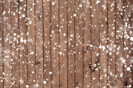 wood backgrounds: Christmas background with falling snow over wooden background Stock Photo