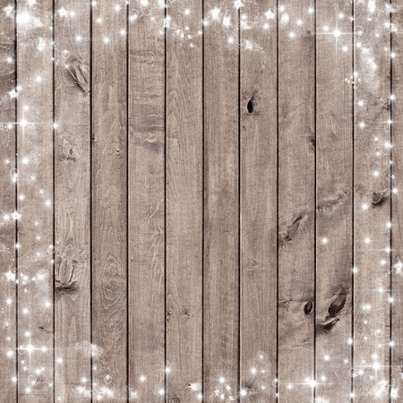 wooden board with snow flakes . Christmas background