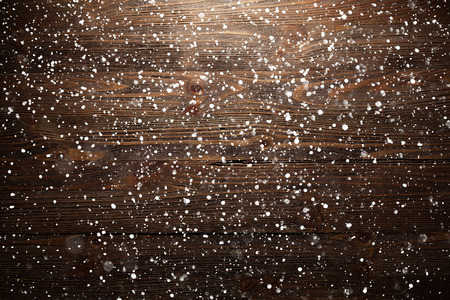 aged wood: Christmas wooden background with falling snowflakes