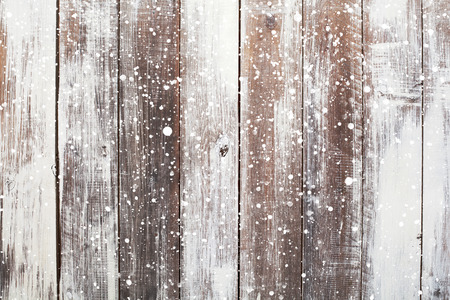 Christmas background with falling snow over wooden background Archivio Fotografico