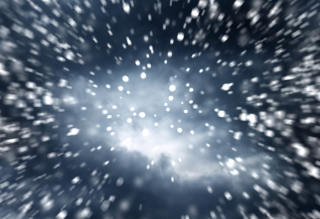 dramatic sky: falling snow on the blue background dramatic dark sky background Stock Photo