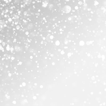 クリスマスの背景。灰色の背景に雪が降る。