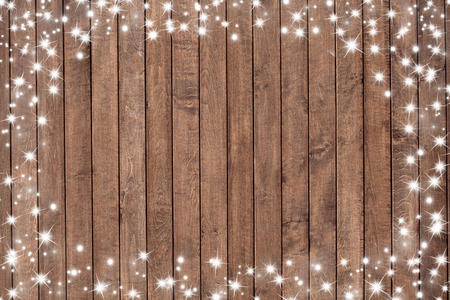Wooden background with snow flakes . Christmas background