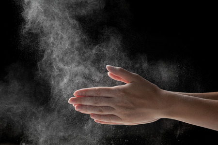 magnesia: woman coating her hands in powder chalk magnesium