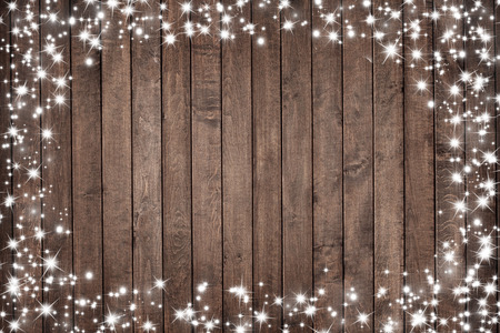 inducement: wooden board with snow flakes . Christmas background