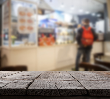 coffee shop: Coffee shop blurred background with bokeh and wooden floor