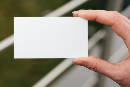 visit card: Hand holding a blank business or visit card Stock Photo