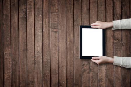 medios de comunicacion: female hands holding digital tablet computer with isolated screen over old grey wooden background table