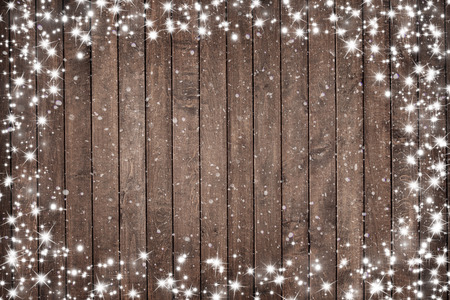 wood panel: Wooden background with snow flakes . Christmas background