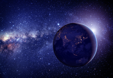 Planet earth from the space in the middle with stars.