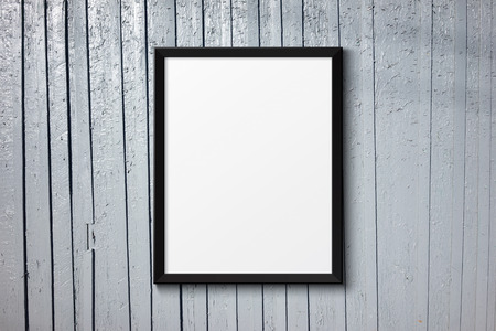blank photo: Blank black picture frame on the painted wood texture