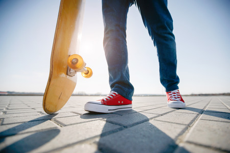 skater riding a skateboard. view of a person riding on his skate wearing casual clothes
