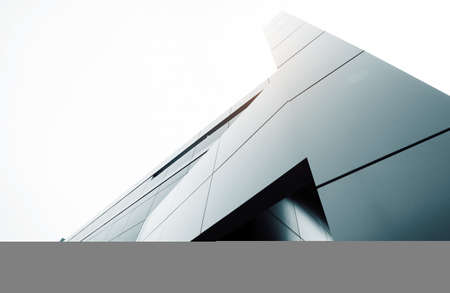 office buildings: Wide angle abstract background view of steel light blue high rise commercial building skyscraper made of glass exterior. concept of successful industrial architecture and office center building Stock Photo