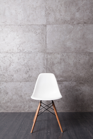 cement wall: grunge wall cement texture with white chair