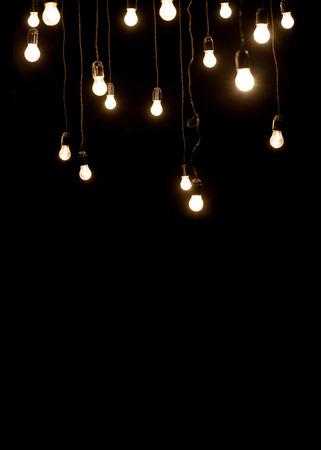 Light bulbs over dark texture Stock Photo