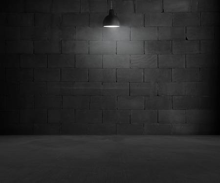 Black brick room interior design with lamp Foto de archivo
